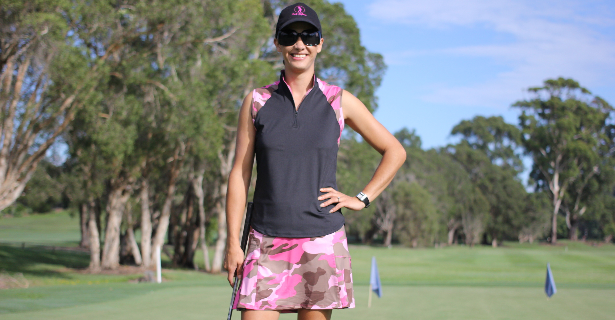 website-kim-in-black-golf-outfit-with-mirage-print-skort.jpg